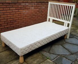 single-size Slumberland sprung bed base + white wooden headboard. In excellent condition.