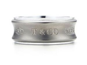 Offering an authentic Tiffany 1837 Sterling silver titanium band