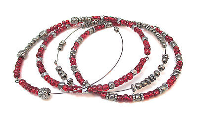 - LOT OF FOUR RED & PEWTER COLORED BEADED BANGLE BRACELETS **