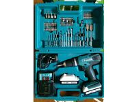 Makita HP457 cordless drill driver with hammer action 2 batteries and case