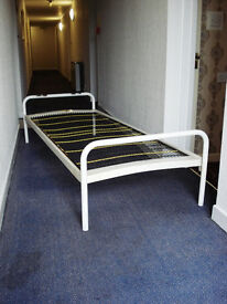 Single bed, metal three-piece construction.