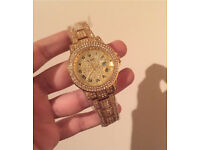 Fully iced out Rolex in gold with box