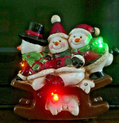 "Adorable Snowman Trio Sled Ceramic Light Up Figurine for Christmas 8""x7.5"" Tall"