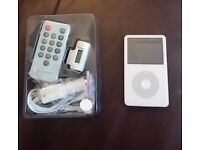 Apple ipod video 30gb white with fm transmitter.