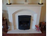 beautiful electric fire and mantlepiece barely used and in immaculate condition.