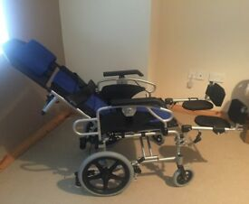 Reclining Foldable Wheelchair, as new, never used.