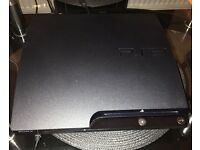 PlayStation 3 in black (very good condition) with games and original wireless controller