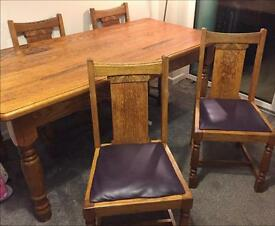 Solid real oak wooden table, four chairs with internal sliding drawer for storage