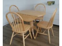 Extendable kitchen/dining table and four chairs