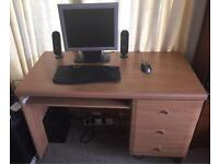 Desk with three drawers and extending tray table