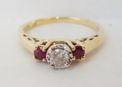 * 10K YELLOW GOLD 10 POINT DIAMOND RING W/ RUBY SIDE STONES IN A MIRACLE SETTING
