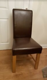 4 x Brown Leather Dining Chair. Braced solid oak legs; Scroll back.