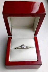 Trilogy emerald cut diamond ring