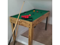 Snooker / pool table with balls, cues & triangle. Good condition.