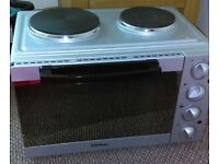 Tabletop Cooker. Oven and grill with two cooking rings/hobs. Hardly used, great condition.