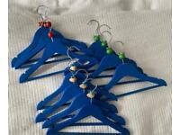 Selection of 11 blue wooden baby/children coat hangers