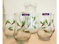 Glass water jug and 4 Glasses