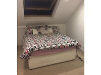 Double bed with mattress and storage inside
