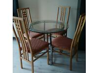 Glass dining table and 4 high back chairs