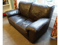 TWO-SEATER DARK BROWN LEATHER SOFA IN VERY GOOD CONDITION