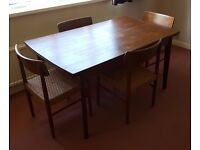 For Sale: 1970s Teak G-Plan Style Extendable Table & Four Split Cane Seat Chairs