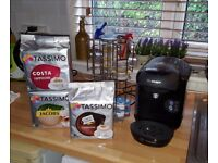Tassimo coffee mashine for sale with pods and a holder