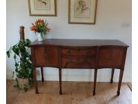 A lovely quality mahogany serpentine fronted sideboard with inlay detailing. Regency style.