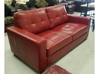 Red leather sofa will seat 3 in fantastic condition can deliver