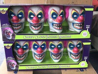 Spirit Halloween Creepy Clown Pathway Markers Lot of 2. 4 per box 8 total New!