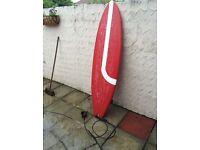 Red fibreglass surfboard