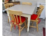Pine wood table, 4 chairs and red seat cushions included, in very good condition