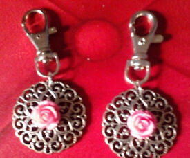 Set of 2 New Matching Silver Tone Round Ornate Cut Out Rose Bag Charms Keyrings.