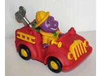 BARNEY THE DINOSAUR VINTAGE WIND UP AND GO CAR VEHICLE 1994