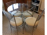 Round Glass Table (and optional free chairs) - needs to be sold