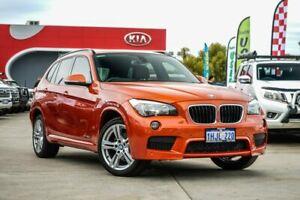 2014 BMW X1 E84 MY0314 xDrive20d AWD Orange 8 Speed Sports Automatic Wagon