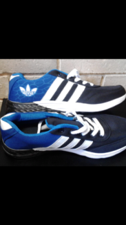 Brand new Adidas size 10 shoes. Black white and blue $15