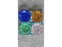 Set of 4 glass ashtrays