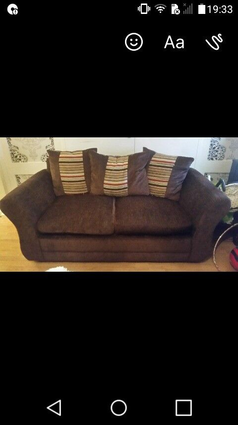 brown fabric sofa with 3 cusions