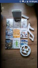 Nintendo Wii with 9 games and balance board