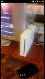 "wii gaming console with 20"" flat screen"