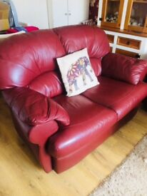 Good condition burgundy leather 2/3 seater sofa good condition great for conservatory etc