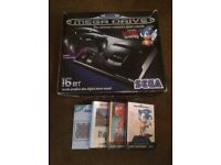 Sega megadrive one 2 controllers and games