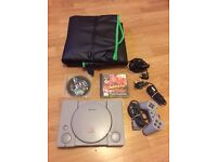 PlayStation 1 console with crash bandicoot game. Ps1