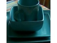 Turquoise square crockery set consisting of small and large plates, bowls, mugs., fifteen items.