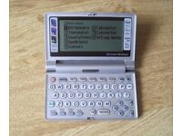 Sharp PWE500A Electronic Dictionary and Thesaurus with Quotations, Crossword and Puzzle Solver