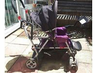 Joovy caboose ride on stroller/buggy