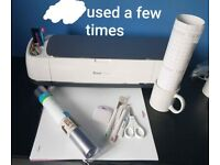 Cricut maker with pens, blades, tools, mats, vinyl and transfer tape