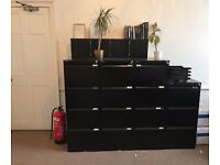 Three, lockable black four drawer Bisley filing cabinets. Great condition. 131cm tall, 47cm wide.