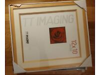 8 sealed (12 inches x 10 inches) photo frames.