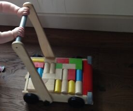Sturdy Wooden Baby Walker With Blocks By Plantoys
